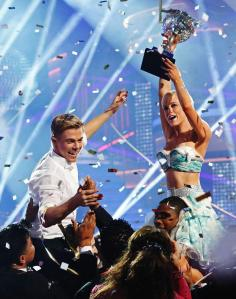 """Albemarle, N.C. native Kellie Pickler (r) and partner Derek Hough receive the Mirror Ball Trophy after being named champions of season 16 of """"Dancing with the Stars"""" on ABC-TV, May 21, 2013. (Kelsey McNeal/ABC photo)"""